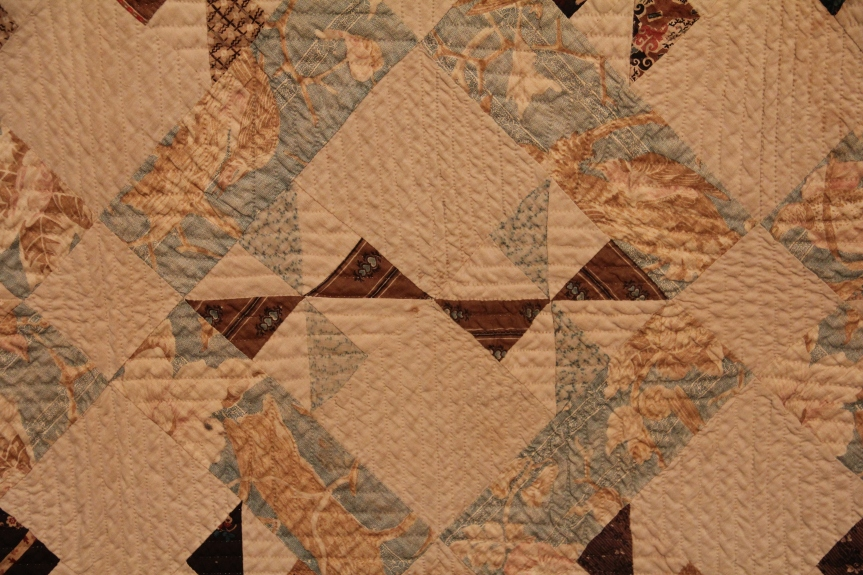 detail of hand quilting on quilt from the 1800's